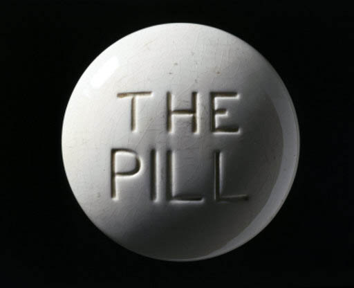 Ceramic paperweight of the contraceptive pill, c 1970.